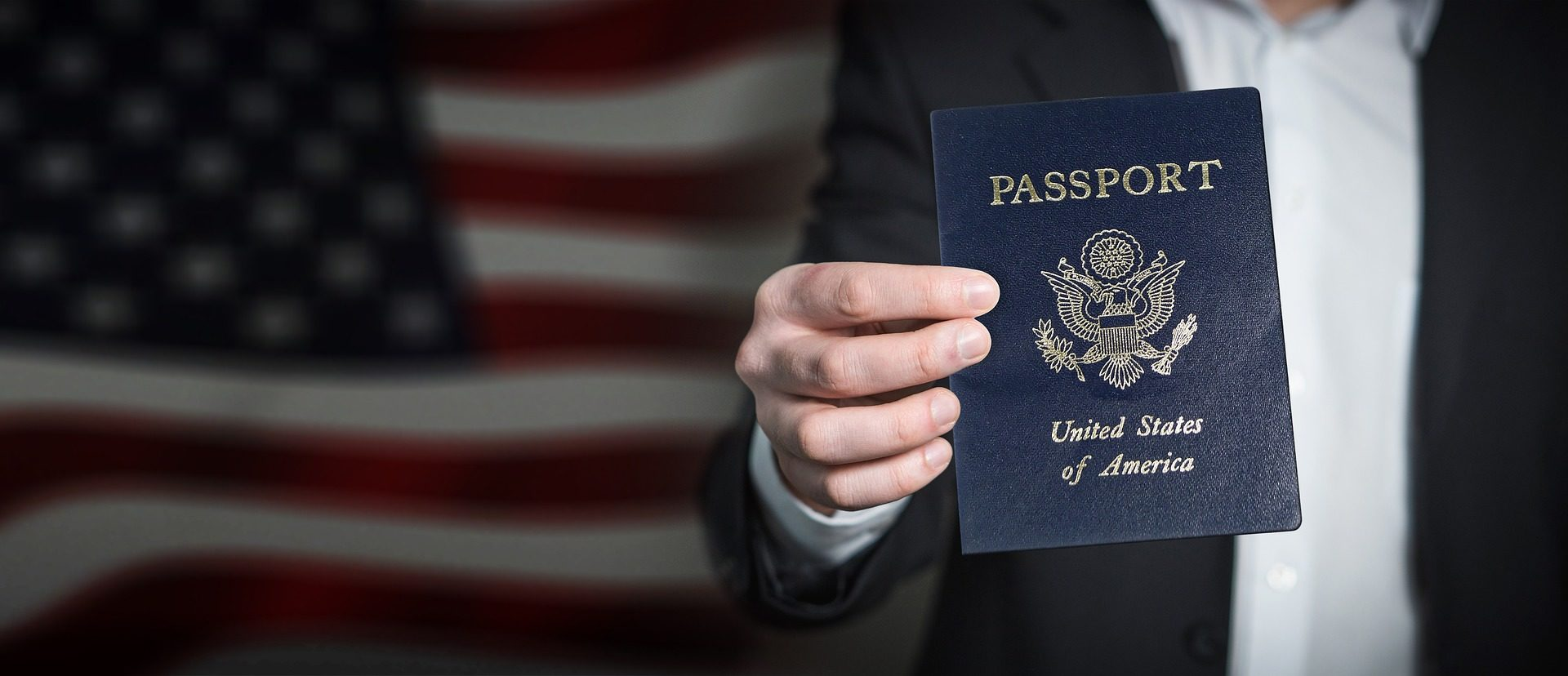 Person holding up U.S. Passport