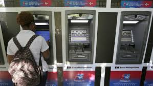 Image showing man withdrawing Cuban money from ATM.